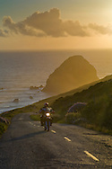 Motorcycle at sunset on the Mattole Road, at Cape Mendocino, on the Lost Coast, California