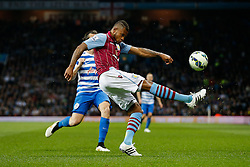 Leandro Bacuna of Aston Villa clears from Joey Barton of QPR - Photo mandatory by-line: Rogan Thomson/JMP - 07966 386802 - 07/04/2015 - SPORT - FOOTBALL - Birmingham, England - Villa Park - Aston Villa v Queens Park Rangers - Barclays Premier League.
