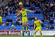 Rotherham's Richard Wood (c) heads clear from Cardiff City's Kenneth Zohore. EFL Skybet championship match, Cardiff city v Rotherham Utd at the Cardiff city stadium in Cardiff, South Wales on Saturday 18th February 2017.<br /> pic by Carl Robertson, Andrew Orchard sports photography.