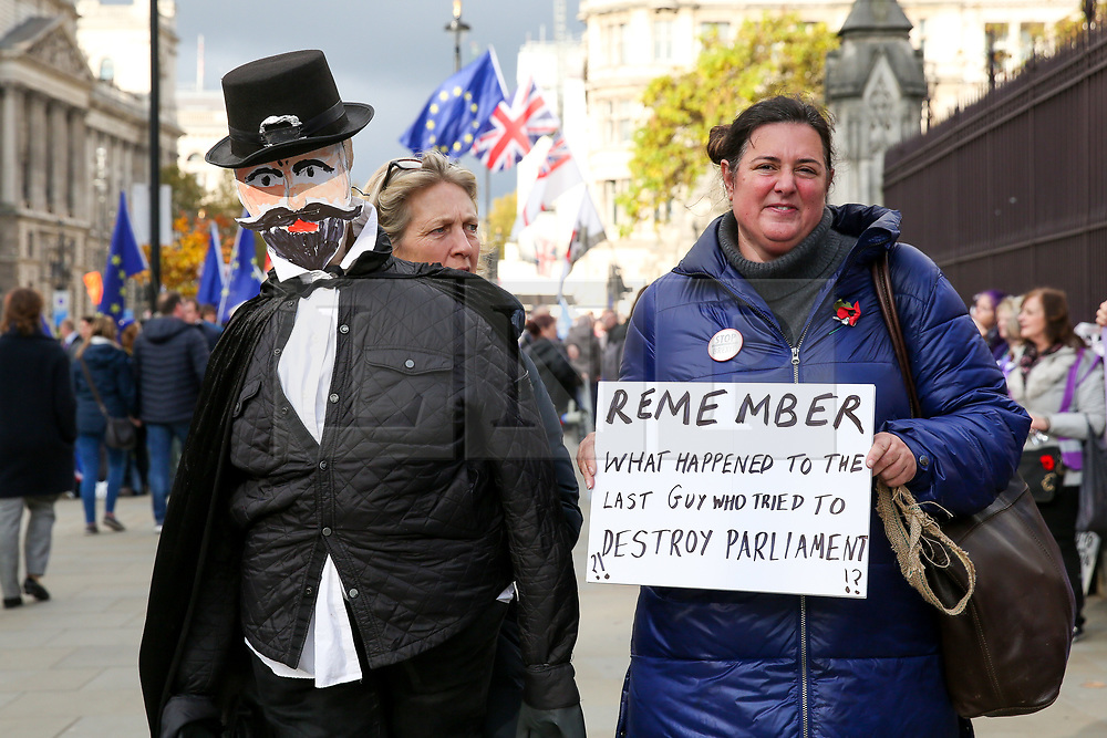 © Licensed to London News Pictures. 05/11/2019. London, UK. Brexit protesters with a puppet of Guy Fawkes protest outside the Houses of Parliament. EU has granted an extension until 31 January 2020 for the UK to leave the European Union. Photo credit: Dinendra Haria/LNP