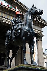 Duke of Wellington Statue with traffic cone on head outside Museum of Modern Art  in Glasgow, Scotland, United Kingdom