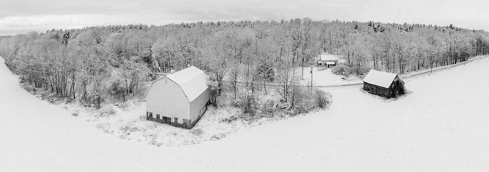 https://Duncan.co/snow-covered-barns-and-forest