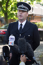 © licensed to London News Pictures. London, UK 05/06/2013. Adrian Usher, Barnet Borough Commander giving a statement to the media whilst fire brigade and forensic officers checking the remainings of the Somali Bravanese Welfare Association in Muswell Hill, London. Police reports suggesting that The Islamic Community Centre had extensive damage by a fire in the early morning. The cause of the fire is currently under investigation and is being treated as suspicious at this stage as an EDL graffiti has been found in the building and media reports suggest that the incident might have links to the Woolwich attack. Photo credit: Tolga Akmen/LNP