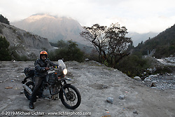 Cool Beans Chris Marino riding a Royal Enfield Himalayan in Motorcycle Sherpa's Ride to the Heavens motorcycle adventure in the Himalayas of Nepal. On the third day of riding, we went from Pokhara to Kalopani. Wednesday, November 6, 2019. Photography ©2019 Michael Lichter.