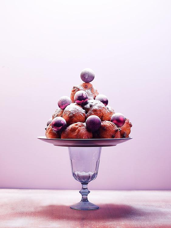 Christmas card with deep fried doughnut balls on a plate