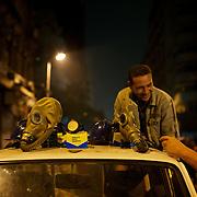 A man sells anti gas masks near Cairo's Tahrir Square