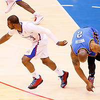 11 May 2014: Los Angeles Clippers guard Chris Paul (3) steals the ball from Oklahoma City Thunder forward Caron Butler (2) during the Los Angeles Clippers 101-99 victory over the Oklahoma City Thunder, during Game Four of the Western Conference Semifinals of the NBA Playoffs, at the Staples Center, Los Angeles, California, USA.