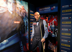 Mark Williams enters the crucible during day seventeen of the 2018 Betfred World Championship at The Crucible, Sheffield.