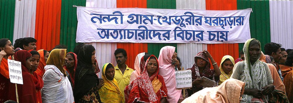 """Photo by Heathcliff Omalley..Calcutta, West Bengal, India 23 March 2007..Thousands of Bengali's gathered in Calcutta today in protest at   State Goverment's poor handling of an intended forced aquisition of  land in the Nandigram area for a """"Special Economic Zone"""" which has now been temporarily put on hold since the killing by police of 14 demonstrators a week ago..  Formerly the Capital of the British Raj until it was moved to Dehli in 1911, Calcutta has been ruled by the Marxist CPI(M) party for the past three decades, making it the longest running democratically elected Communist government in the world."""