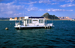 AZ, Arizona Lake Powell, near Grand Canyon National Park, scenic, house boat in foreground, Utah border in background  .Photo Copyright: Lee Foster, lee@fostertravel.com, www.fostertravel.com, (510) 549-2202.Image: azlkpo215