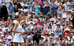 Karolina Pliskova acknowledges the crowd after beating against Victoria Azarenka on day three of the Wimbledon Championships at the All England Lawn Tennis and Croquet Club, Wimbledon.