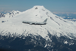 "OAK HARBOR, Wash. (May 22, 2017) A P-8A Poseidon assigned to the ""Skinny Dragons"" of Patrol Squadron (VP) 4 flies near Mount Baker during a training exercise. VP-4 is stationed at Naval Air Station Whidbey Island, Calif., and became the first P-8 squadron on the west coast following a successful transition from the P-3C Orion aircraft. (U.S. Navy photo by Mass Communication Specialist 3rd Class Juan S. Sua/Released)170522-N-CR843-313 <br />
