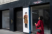 Printed figure of a Beefeater as seen at the Tower of London in a closed down shop window in the upmarket area of Knightsbridge on 14th April 2021 in London, United Kingdom. Knightsbridge is one of the principal areas for exclusive, luxury goods in West London. It is known as a district where the rich and wealthy shop, mostly for high end fashion and jewellery.