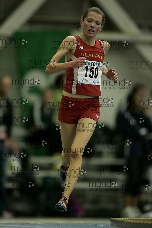 (Windsor, Ontario---12 March 2010) Rachel Cliff of University of Guelph Gryphons   competes in the 3000m final at the 2010 Canadian Interuniversity Sport Track and Field Championships at the St. Denis Center. Photograph copyright Geoff Robins/Mundo Sport Images. www.mundosportimages.com