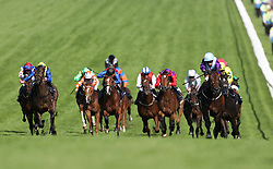 Dash Of Spice ridden by jockey Silvestre de Sousa (purple silks, right) coming home to win the Investec Out Of The Ordinary Handicap during derby day of the 2018 Investec Derby Festival at Epsom Downs Racecourse.