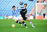 Huddersfield Town's Oliver Norwood shields the ball from Leicester City's Andy King ..Football - FA Challenge Cup Fourth Round - Huddersfield Town v Leicester City - Saturday 26th January 2013 - The Galpharm Stadium - Huddersfield..
