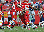 KANSAS CITY, MO - SEPTEMBER 15:  Quarterback Alex Smith #11 of the Kansas City Chiefs rolls to the outside against the Dallas Cowboys during the second half on September 15, 2013 at Arrowhead Stadium in Kansas City, Missouri.  Kansas City defeated Dallas 17-16. (Photo by Peter Aiken/Getty Images) *** Local Caption *** Alex Smith
