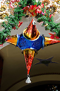 A punched tin star-shaped ornament, Tule, Mexico.