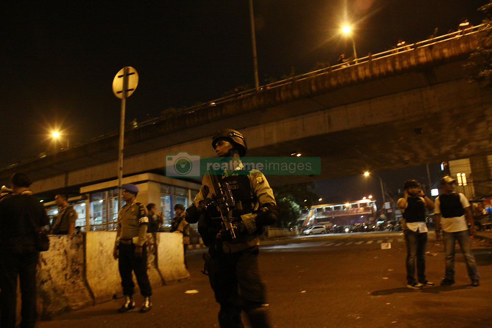 May 24, 2017 - East Jakarta, Capital Region of Jakarta, Indonesia - Police and military officers stand guard in the location of two bomb blast which occurred at Kampung Melayu bus terminal, Jakarta, on Wednesday night, 24 May, 2017. According to the witness in the location, the first bomb blast at 21.00 pm, and the second bombs was blasted 5 minutes later after 5 police officers come to the location. Deputy Chief Of Indonesian Police, Commissioner General Police Syafruddin confirmed that 4 police officers and 5 civilian wounded, meanwhile two bodies found at the site is a policeman and a suspected bomber. (Credit Image: © Tubagus Aditya Irawan/Pacific Press via ZUMA Wire)