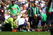 Will Hughes of Derby County receives treatment for an injury . Skybet football league championship match, Bolton Wanderers v Derby County at the Macron stadium in Bolton, Lancs on Saturday 8th August 2015.<br /> pic by Chris Stading, Andrew Orchard sports photography.