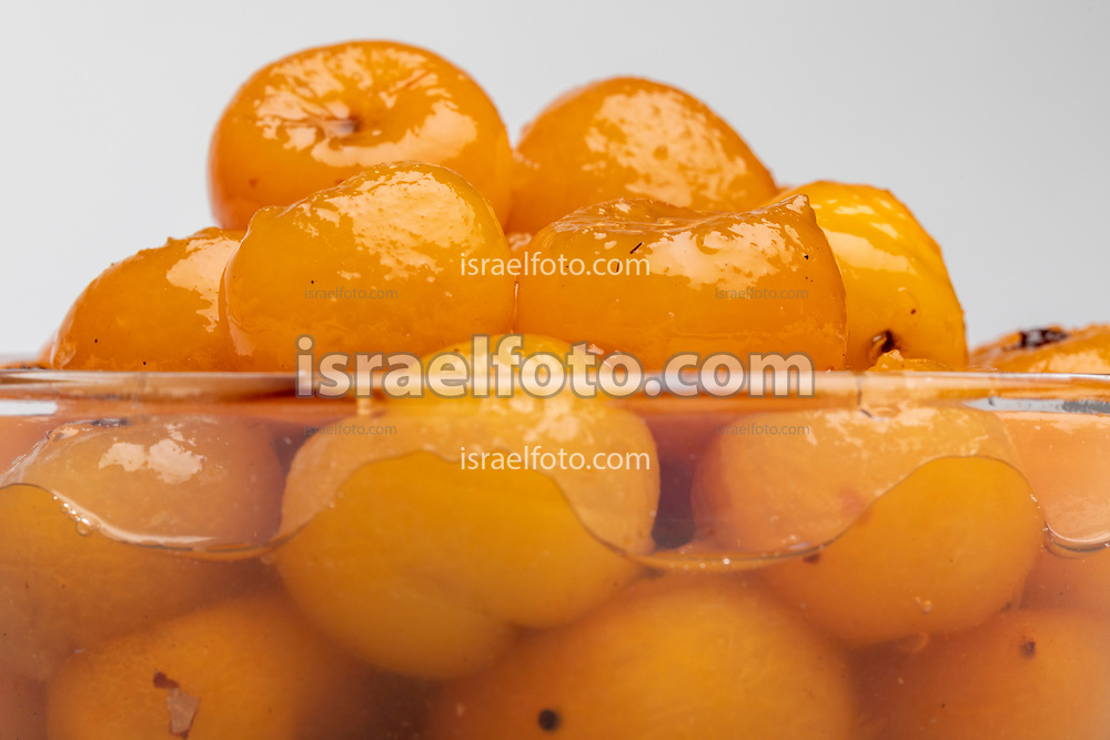 Tejocotes (mexican hawthorn) in heavy syrup. Tejocotes are a seasonal fruit available in autumn an early winter. In this photo they are prepared in heavy syrup.