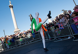 © Licensed to London News Pictures. 16/03/2014. London, UK. A participant of the St Paddy's Day parade showing off some dance moves to spectators at Trafalgar Square. Photo credit : David Tett/LNP