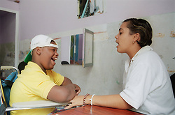 Child with cerebral palsy receiving speech therapy at centre for rehabilitation and education in Havana; Cuba,