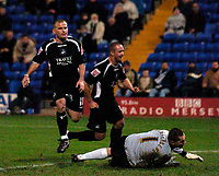 Photo: Jed Wee.<br />Tranmere Rovers v Swansea City. Coca Cola League 1.<br />26/11/2005.<br />Swansea's Andy Robinson (L) scores their second equaliser of the game after chipping the ball past Tranmere goalkeeper John Achterberg.