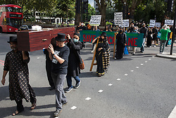 London, UK. 12th September, 2021. Local residents and supporters of the Save Brick Lane campaign take part in a funeral procession from Altab Ali Park to Brick Lane organised in protest against the ongoing gentrification of Shoreditch. Campaigners are protesting in particular against plans to develop the Truman Brewery into a shopping centre and 5-storey office building. Tower Hamlets experienced more gentrification than any other London borough between 2010-2016.