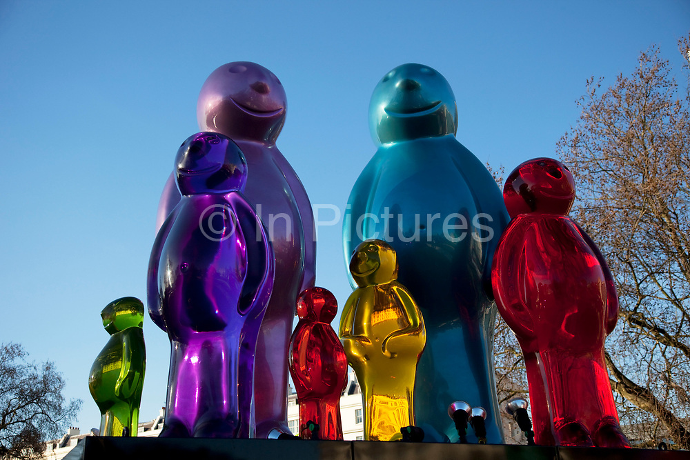 """A family of colourful jelly baby sculptures standing up to 10.5ft (3.2m) high at Marble Arch, London. The Jelly Baby Family is the work of sculptor Mauro Perucchetti. The statues are part of the City of Sculpture Festival which will include installations donated by some of the world's leading galleries and artists.The """"father"""" is the largest of the colourful jelly baby figures, while the smallest of the jelly babies, the """"child of the family"""" will be 7.5ft (2.3m)."""