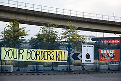 London, UK. 8th September, 2021. Banners are pictured during Stop The Arms Fair protests outside ExCeL London as preparations for the DSEI 2021 arms fair continue. The third day of week-long Stop The Arms Fair protests outside the venue for one of the world's largest arms fairs was themed around demilitarising education.