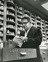 1960 Sidney Skolsky checking his mail at Schwab's Drugstore