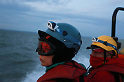 Victoria Henry and Phill Ball who boarded the cargo ship, heading out to meet the ship at sea September 21st 2017, Thames Estuary, Kent, United Kingdom. Greenpeace volunteers in kayaks, speed boats and climbers on the jetty prevent the 23,498-tonne cargo ship Elbe Highway from docking at Sheerness in Kent.  The cargo ship is bringing Volkswagen diesel cars into the UK and the Greenpeace action is to prevent this from happening and to make VW ditch diesel. Two climbers board the ship and hang a banner on the roll-on roll-off part of the ship preventing any cars from being off-loaded.The action is part of a long running Greenpeace campaign to curb diesel emmissions and air pollution broght on by diesel cars.
