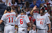 ATLANTA, GA - AUGUST 30:  Third baseman Ryan Zimmerman #11 of the Washington Nationals is congratulated by Rick Ankiel #24 (blocked by Zimmerman), shortstop Ian Desmond #6 and pitcher Livan Hernandez #61 after Zimmerman's three run home run during the game against the Atlanta Braves during the game at Turner Field on August 30, 2011 in Atlanta, Georgia.  (Photo by Mike Zarrilli/Getty Images)
