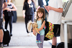 September 7, 2017 - Fort Lauderdale, Florida, U.S - Kylie McKenna, 5, of Hollywood, Fla., waits for departure to Atlanta at fort Lauderdale-Hollywood International Airport, ater a mandatory evacuation has been ordered to her family's area of residence in fear of possible impact of Hurricane Irma. (Credit Image: © Orit Ben-Ezzer via ZUMA Wire)