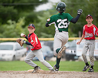 Colby Brown of Belmont looks for the double play after tagging Tyler Haskell of Newfound out at second during U12 Cal Ripken Tournament action at Prescott Park in Meredith Tuesday evening.  (Karen Bobotas/for the Laconia Daily Sun)