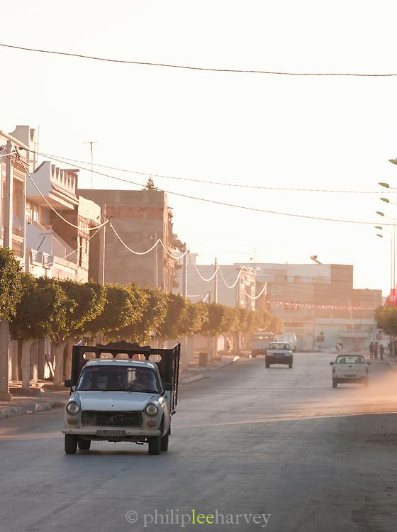 Traffic on dusty road in El Djem, Tunisia