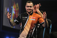 Benito van de Pas wins his third round match against Toni Alcinas and celebrates during the World Darts Championships 2018 at Alexandra Palace, London, United Kingdom on 27 December 2018.