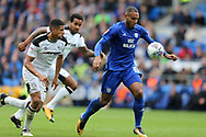 Kenneth Zohore of Cardiff city ® breaks away from Curtis Davies of Derby county (l). EFL Skybet championship match, Cardiff city v Derby County at the Cardiff city stadium in Cardiff, South Wales on Saturday 30th September 2017.<br /> pic by Andrew Orchard, Andrew Orchard sports photography.