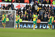 Norwich city players look on dejected at the final whistle after they lose the game. Barclays Premier league match, Swansea city v Norwich city at the Liberty Stadium in Swansea, South Wales  on Saturday 5th March 2016.<br /> pic by  Andrew Orchard, Andrew Orchard sports photography.