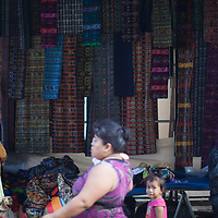 At the market in Telemán, vendors display 'cortes', the traditional skirt used by indigenous people.