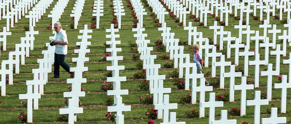 Grandfather with grandson at Cemetery of Douaumont at the Ossuaire de Douaumont, Fleury-devant-Douaumont near Verdun, France