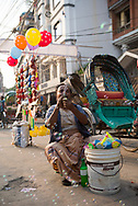 Dhaka, Bangladesh - November 1, 2017: A man selling children's toys on the street outside Lalbagh Fort blows bubbles in Dhaka, Bangladesh.