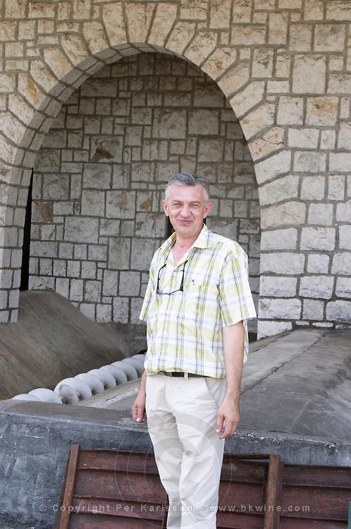 Tihomir Prusina, the oenologist. In front of the grape reception area. Vinarija Citluk winery in Citluk near Mostar, part of Hercegovina Vino, Mostar. Federation Bosne i Hercegovine. Bosnia Herzegovina, Europe.
