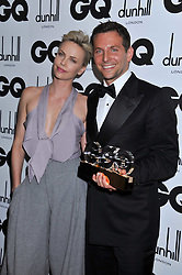 CHARLIZE THERON and Winner of the International Man of the Year Award BRADLEY COOPER at the GQ Men of the Year 2011 Awards dinner held at The Royal Opera House, Covent Garden, London on 6th September 2011.