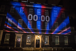 London, UK. 31 January, 2020. A Brexit countdown clock projected onto 10 Downing Street displays the moment when the UK leaves the European Union.