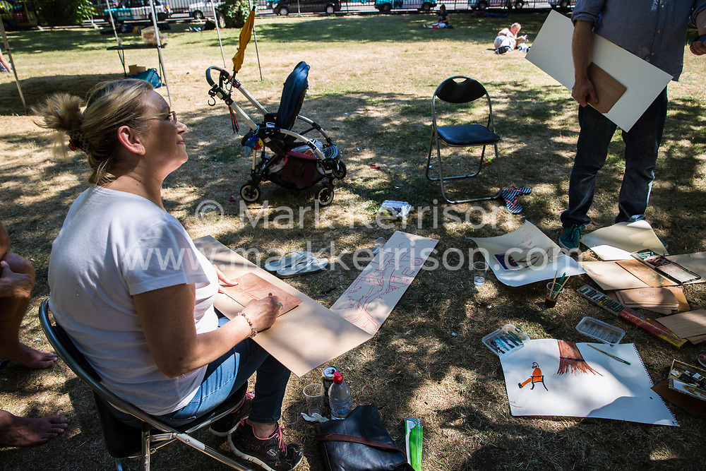London, UK. 26th June 2018. Local residents protest using art against the planned felling by HS2 Ltd of mature London Plane, Red Oak, Common Lime, Common Whitebeam and Wild Service trees in Euston Square Gardens to make way for temporary sites for construction vehicles and a displaced taxi rank as part of preparations for the HS2 high-speed rail line. The protest, involving the capturing of images of the trees on paper using a variety of different techniques, was hosted by the artist Dan Llywelyn Hall as 'The Last Stand Against the Environmental Damage of HS2'.