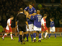 Fotball<br /> Foto: SBI/Digitalsport<br /> NORWAY ONLY<br /> <br /> Leicester City v Coventry City<br /> Coca Cola Championship. 08/11/2004.<br /> <br /> Leicester City's Lilian Nalis (#8) is mobbed by teammates after putting his side 1-0 up.
