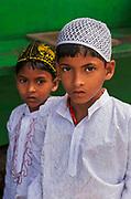 Muslim boys on pilgrimage to the sacred Ajmer Sharif or Dargah Sharif, a sufi shrine (dargah) of the revered sufi saint, Moinuddin Chishti. Ajmer, Rajasthan.
