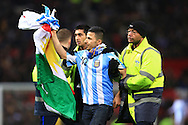 A pitch invader waves to admiring fans - Argentina vs. Portugal - International Friendly - Old Trafford - Manchester - 18/11/2014 Pic Philip Oldham/Sportimage
